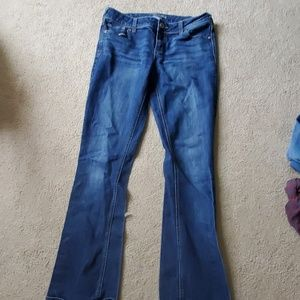 Dark Jean's with some distress wash at top